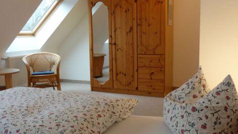 Schlafzimmer - Ferienwohnungen Gutshaus Henningsfelde